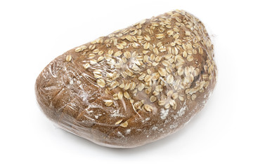 Baked bread with seeds wrapped in cellophane