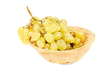 Fresh grapes in Fruit Basket isolated on white background