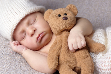 sleeping baby with teddy bear