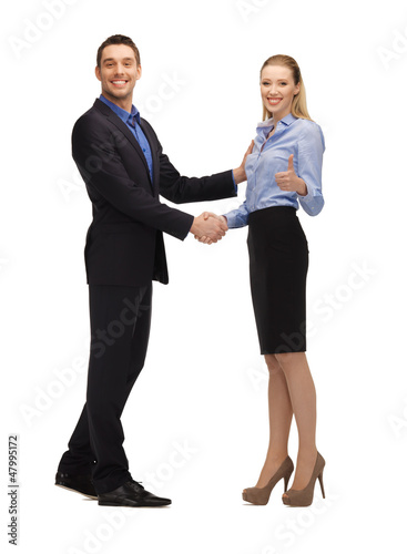man and woman shaking their hands