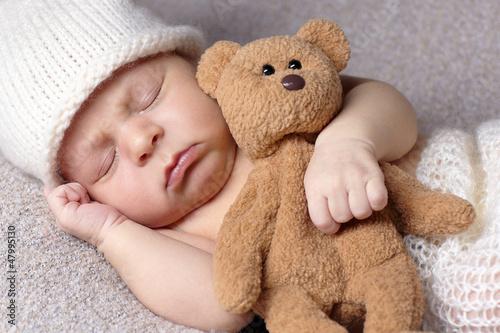 sleeping baby with teddy bear