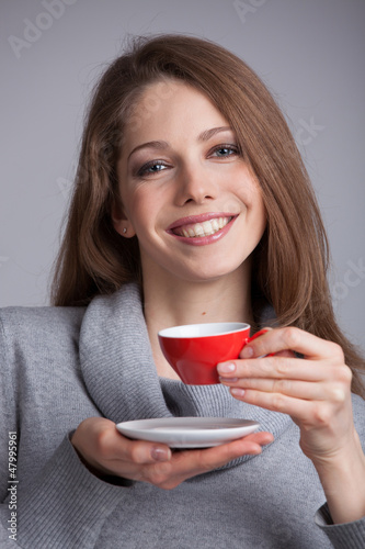 Cute girl holding a cup of coffee
