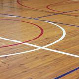 Wooden floor of sports hall with marking lines