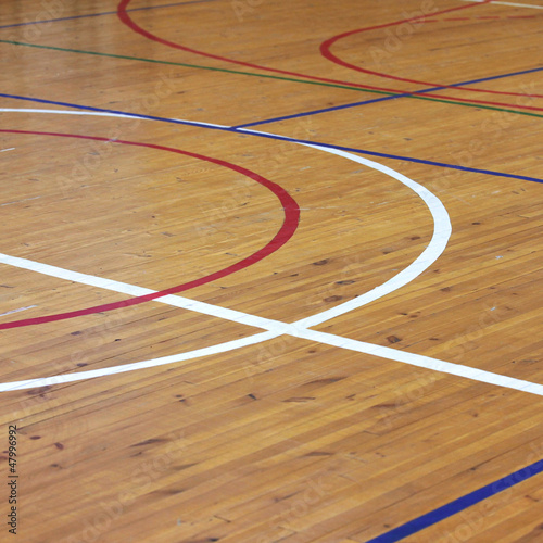 Fotobehang Stadion Wooden floor of sports hall with marking lines