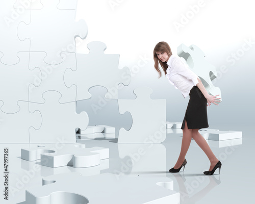 Businesswoman with a puzzle pieces