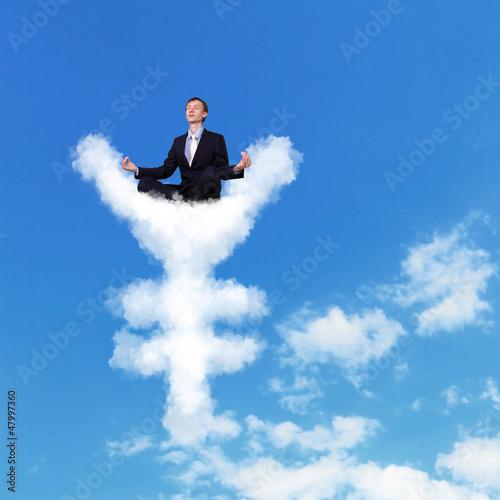 Businessman meditating sitting on the cloud