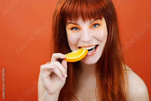 girl with slice of orange
