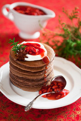 Chocolate pancakes with spiced and goji berries sauce
