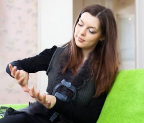 beauty woman looks at nails