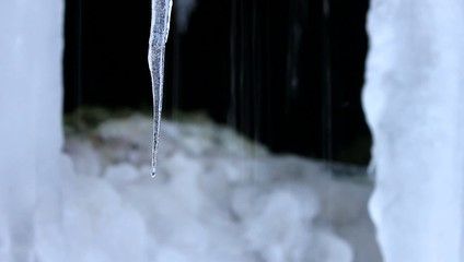 Icicles and flowing water