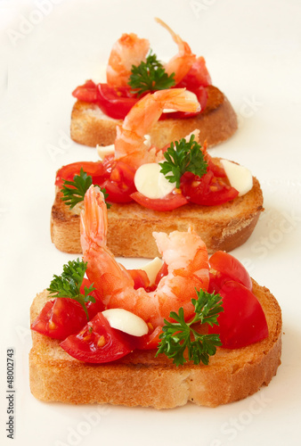 toasts with tomatoes and shrimp