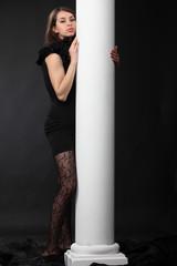 Girl stay near white column