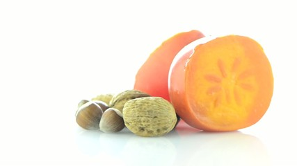 Ripe persimmon and nuts