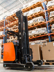 Forklift stacker loader in wharehouse