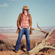 blond cowgirl in the desert