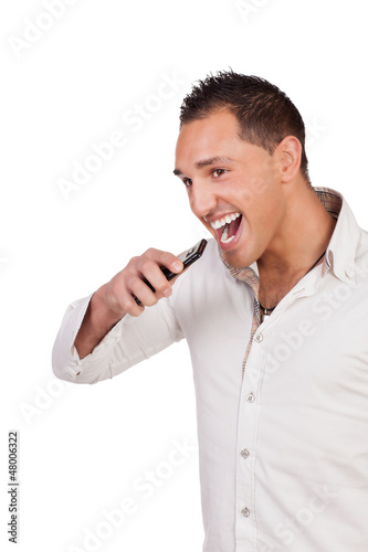 Ecstatic man holding a mobile and laughing