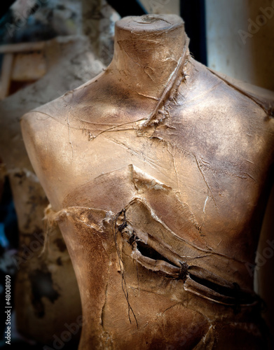 Old slashed mannequin