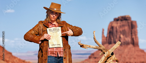 panoramic view of bad cowgirl with wanted paper