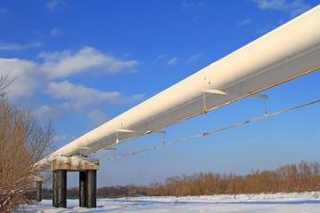 The high pressure pipeline in a winter landscape