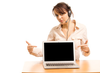 Woman wearing a headset pointing to her laptop