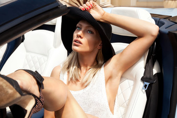 Sexy lady in the sport car