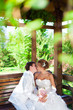 Couple in love bride and groom posing in gazebo