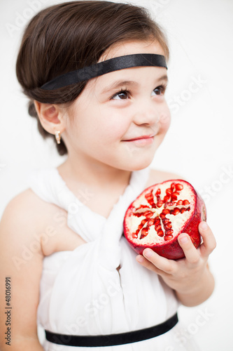 child model view in luxurious white dress with pomegranate