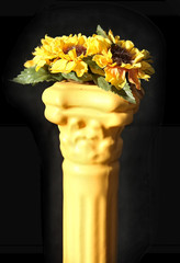 yellow vases made of clay painted with flowers