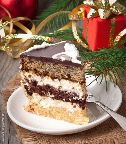 Christmas cakes on wooden background