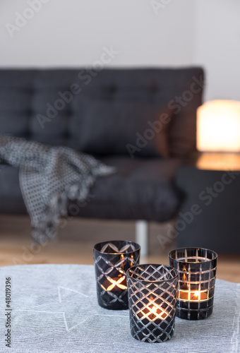 Tea-lights decorating living room with gray sofa