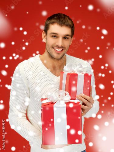 man holding many gift boxes