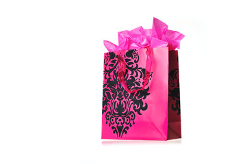 a pink shopping bag isolated on white background