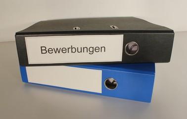 Aktenordner 1x schwarz Bewerbungen 1 x blau Stapel
