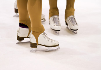 Closeup of figure skating ice skates in action