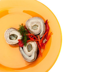Rolls of herring with pickled cucumber and pepper