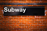 New York City subway sign entrance on brick wall
