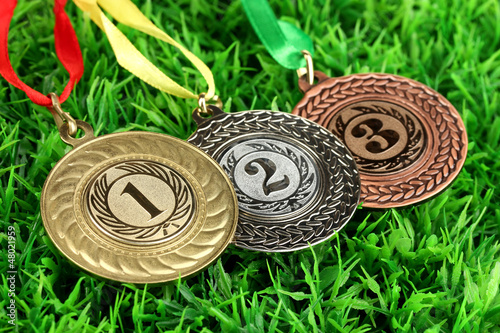 Three medals on grass background
