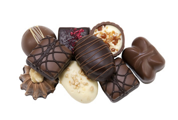 assortment of delicious pralines on a white background