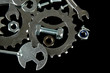 Machine gear, metal cogwheels, nuts and bolts isolated on black
