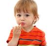 cute little boy eating tangerine, isolated on white