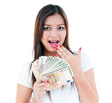 Excited Young Woman Holding Cash