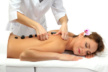 beautiful woman in spa salon with spa stones  getting massage, © Africa Studio