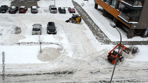 cars stand block house parking tractors clean winter snow