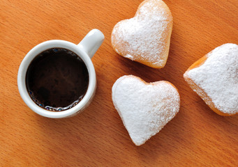 Donut in the shape of heart with coffee