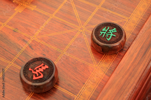 chessmen of chinese chess china in woodiness board