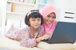 Southeast Asian children surfing internet