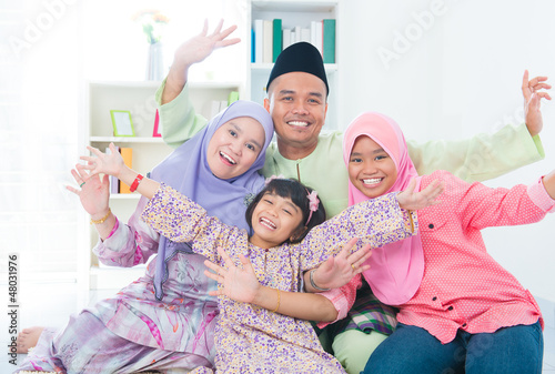 Excited Southeast Asian family