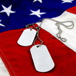 Military dog tags on vivid stars and stripes background