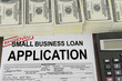 Approved small business loan application form and money