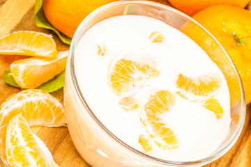 Orange  mandarin Yoghurt in the glass